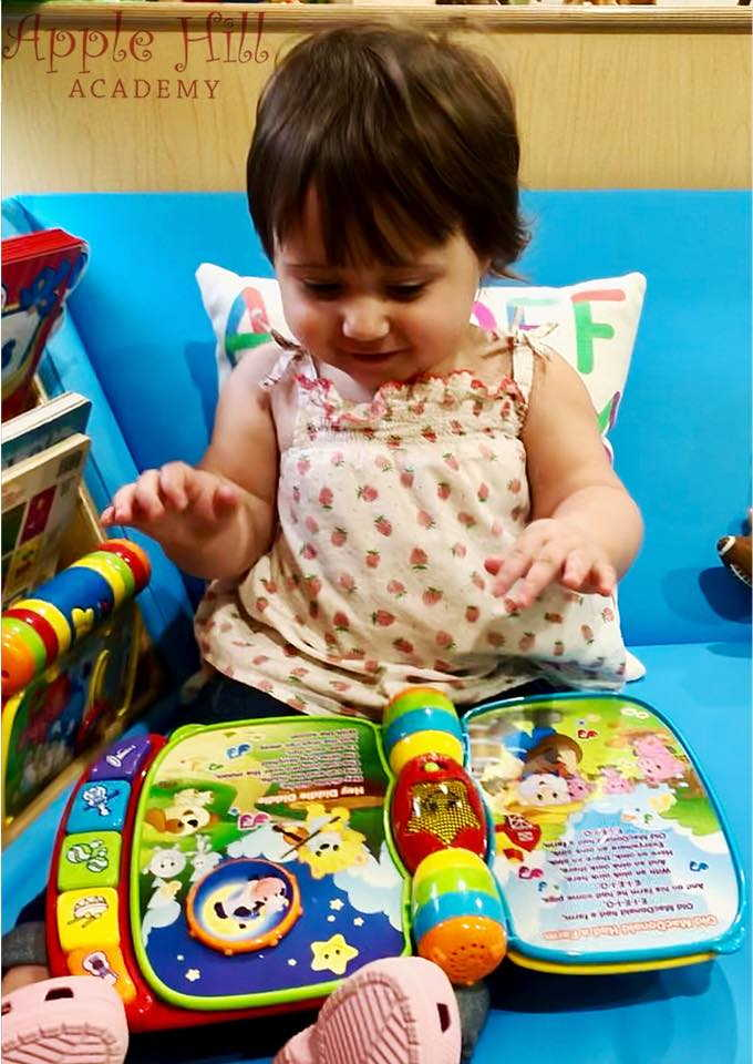 Toddler with interactive book